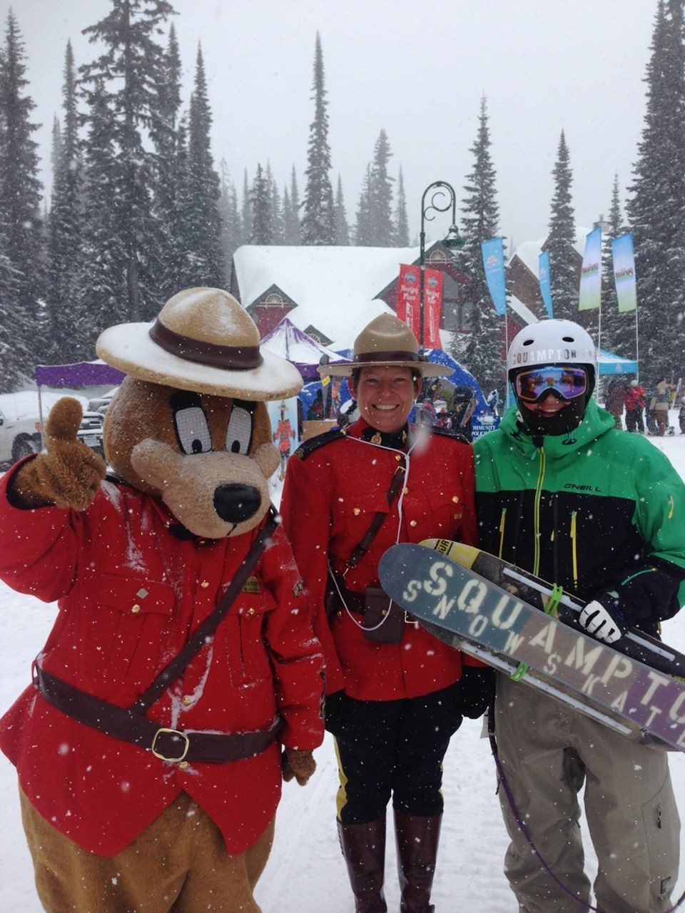 Me and the ever present RCMP full of smiles... Snowskating is NOT a crime!