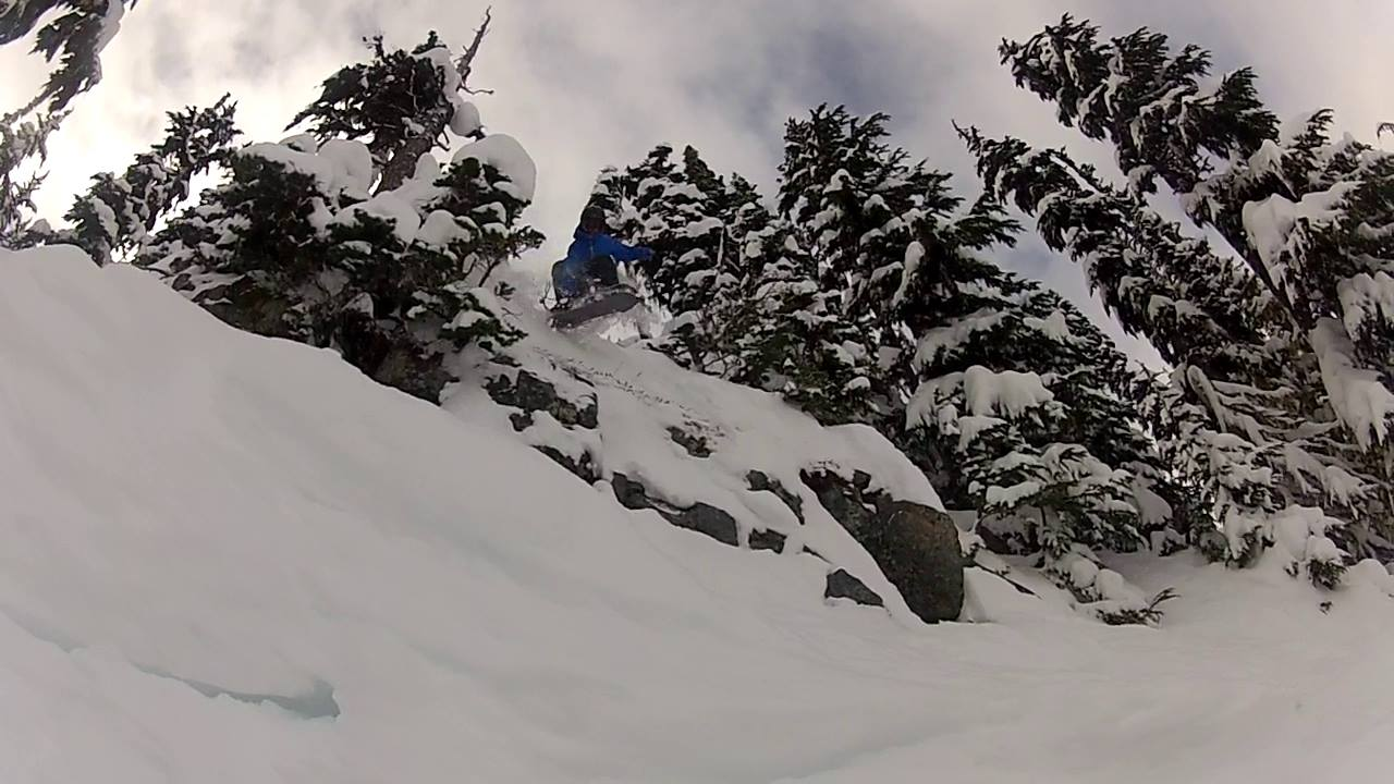 Jesse Davidson finishes a Fragel Rock run with this drop out of a chute full of early season powder on Blackcomb