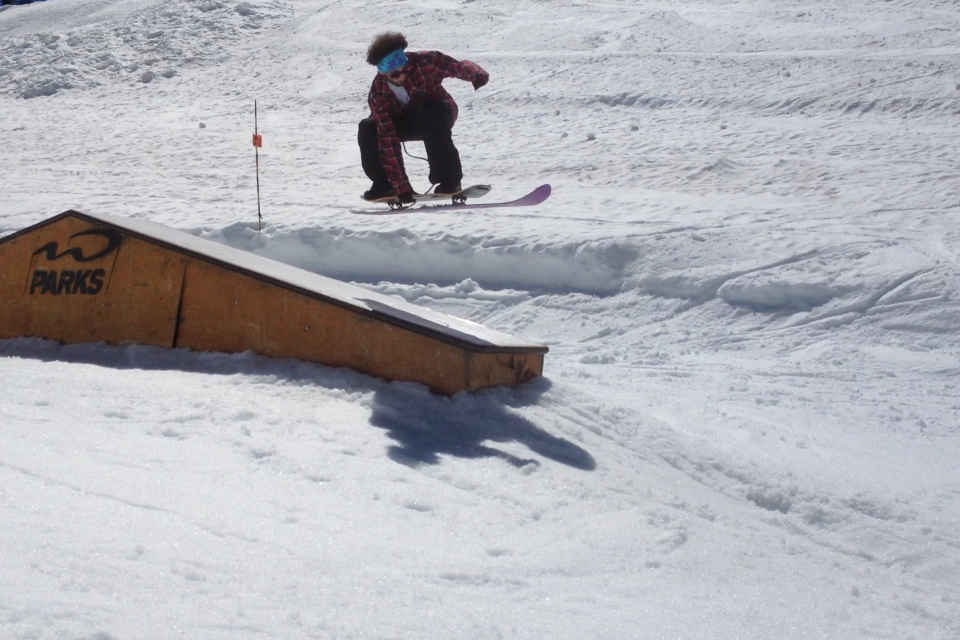 Canada Day - Jesse Davidson gaps the up-down box on Blackcomb glacier with the Purple Powder Eater