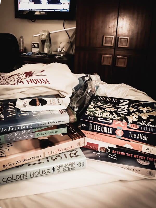 Back in the hotel room, we lined up all the free books we got.  We also got a wine glass, wine opener, and peanut butter cups.  Scored big here.  There is nothing more comforting than a huge pile of books waiting to be cracked open and enjoy.  Oh, yes, we will be going again.