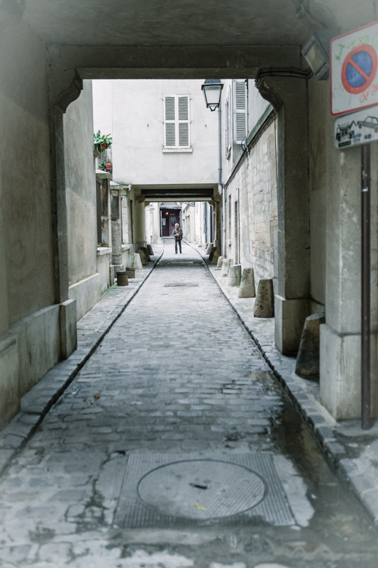 An alleyway leading to the back door of a very old church…I love the old street lamps and cobblestone.