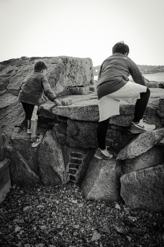 When we were done with the wharf side of Bearskin neck we crossed over to the ocean side. On this side, they found lots of boulders to climb on and of course, more rocks to toss.