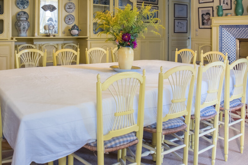 This is the dining room with its bright yellow and blue color scheme. The tiles on the fireplace were extraordinary as were all the blue pots lining a few decorative shelves.