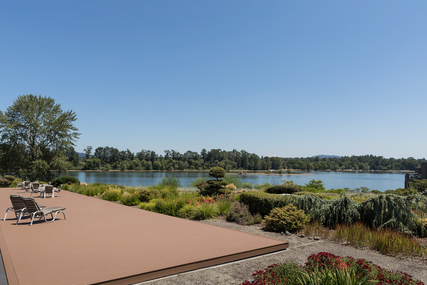 The patio in Willamette Shores Commons overlooking the river is a great place to entertain or relax.