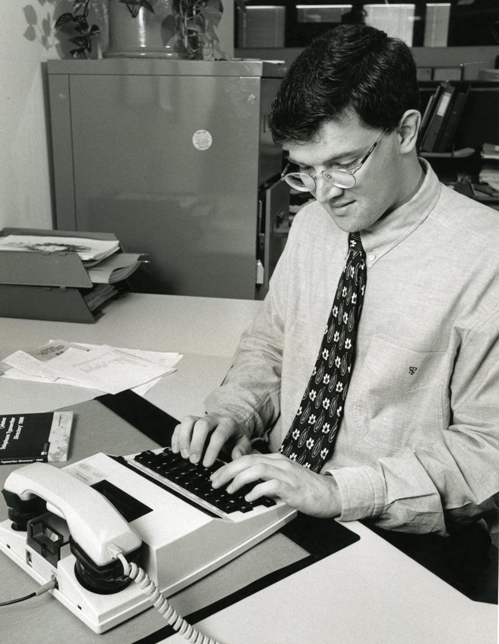 Stephen Nicholson using a TTY, 1990s