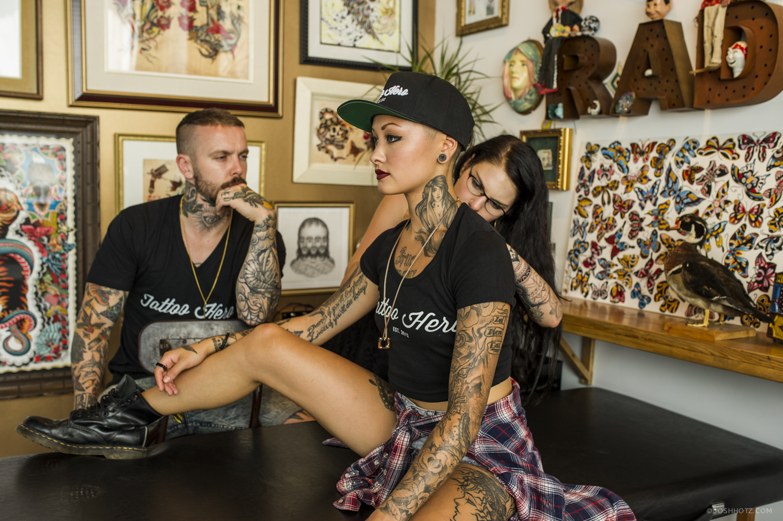 Amber Allen of Tattoo Hero making some adjustments on Samantha Knoxx