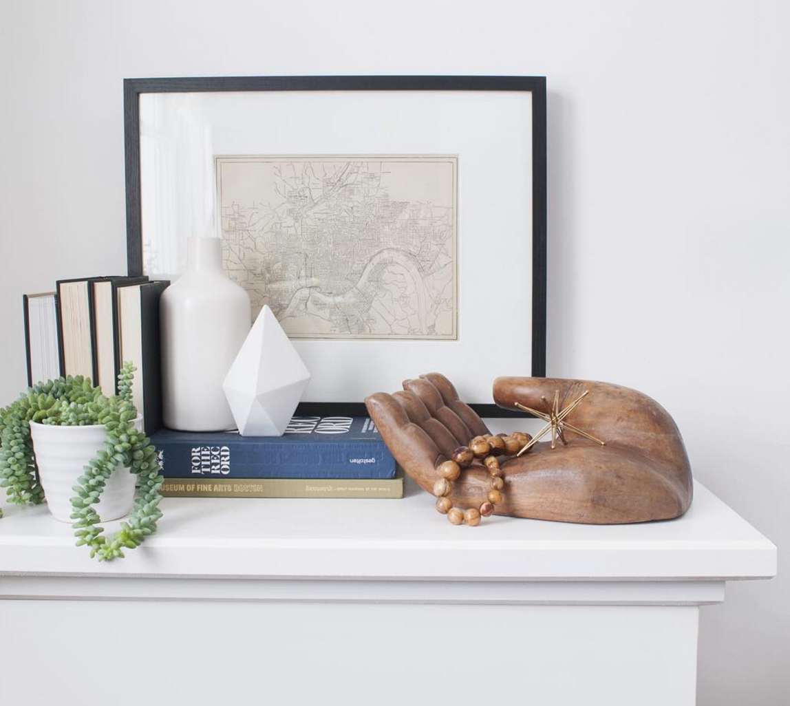 Charm  ~ Personality is what this is all about. Creating a vignette can tell a small story. Individual pieces with charm give a lot of character to a small nook. Image via  Sarah Gibbs