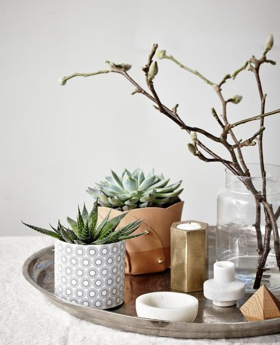Variation  ~ Always remember to keep things interesting with variation in height, texture, and patterns. Here you have a common theme, each item plays well together but there is variation in the arrangement. Image via kkno
