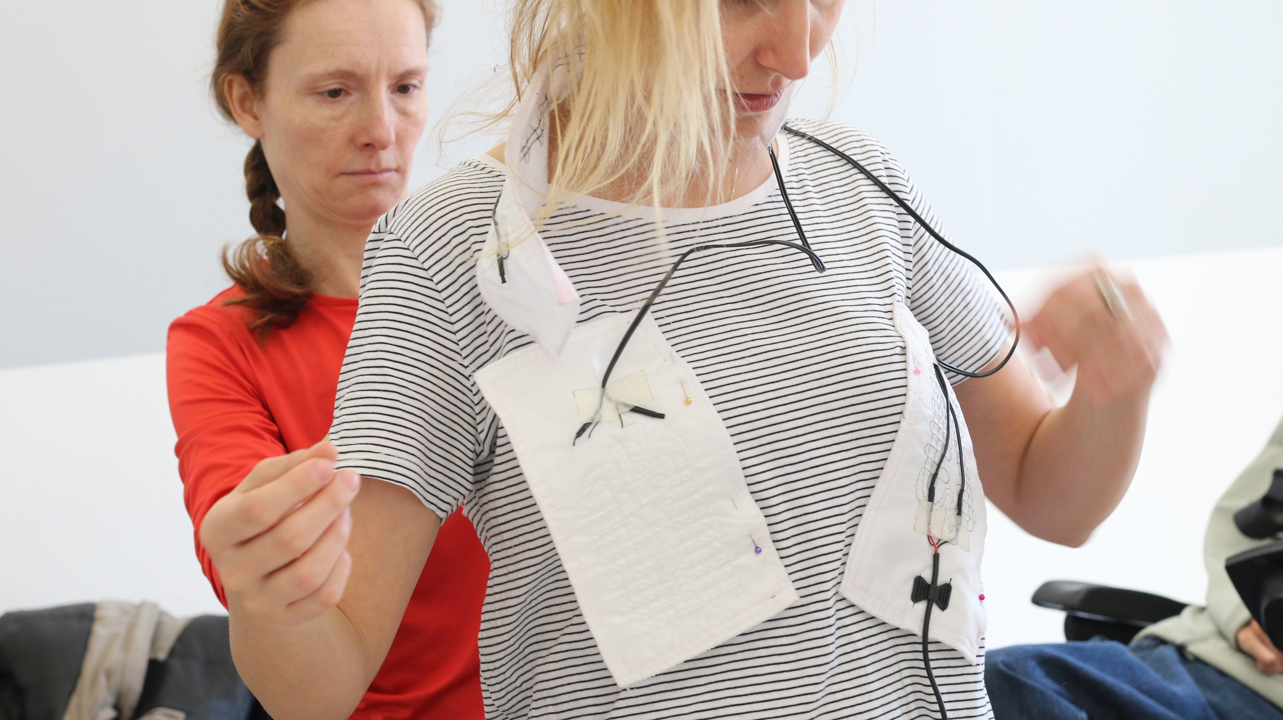 Evrim Büyükaslan testing the heating pads for her team's garment solution.