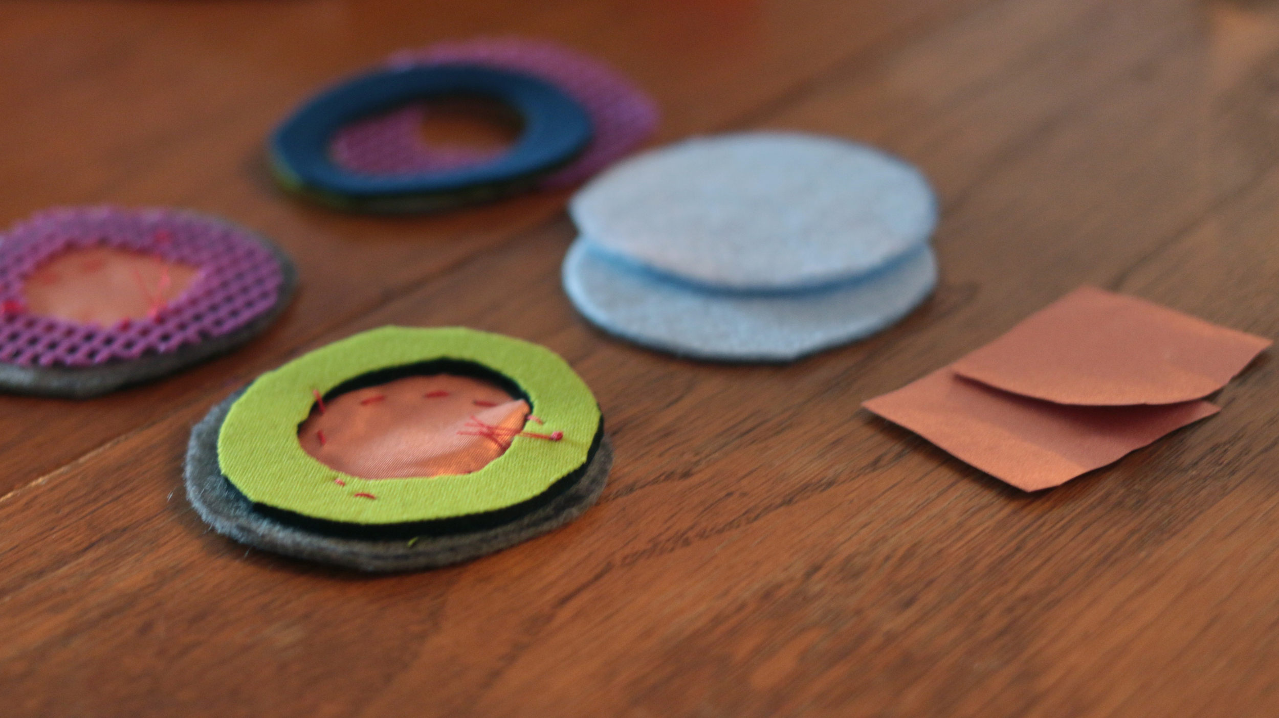 My pieces for a simple button switch using conductive fabric. (*Thanks to   Alex Tosti   for materials). Below are two images of a work-in-progress by   Kristin Slater  .