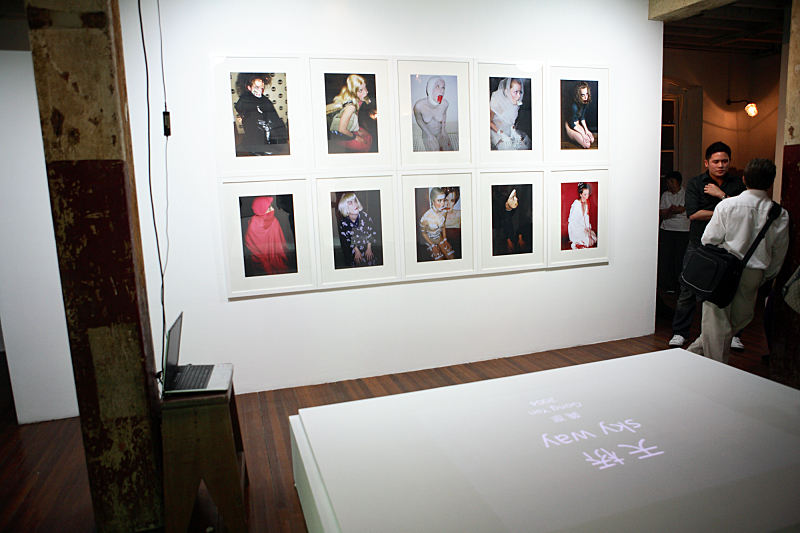 """Installation view, Eurasia One at the Island 6 gallery warehouse, Susanne Junker, """"figures for the base of a crucifixion #1-#10"""", 2007."""