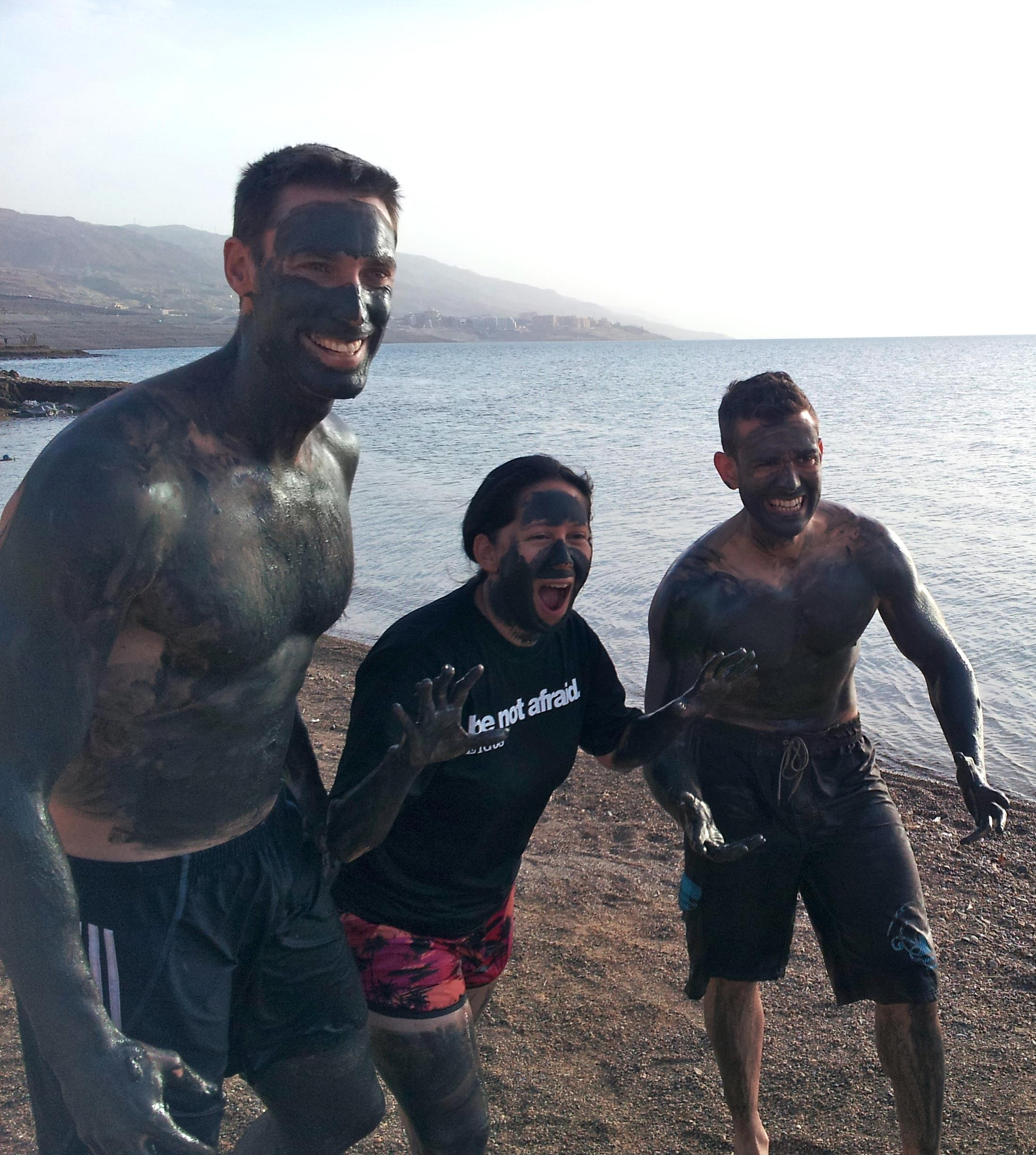 Enjoying the Dead Sea mud while on pilgrimage