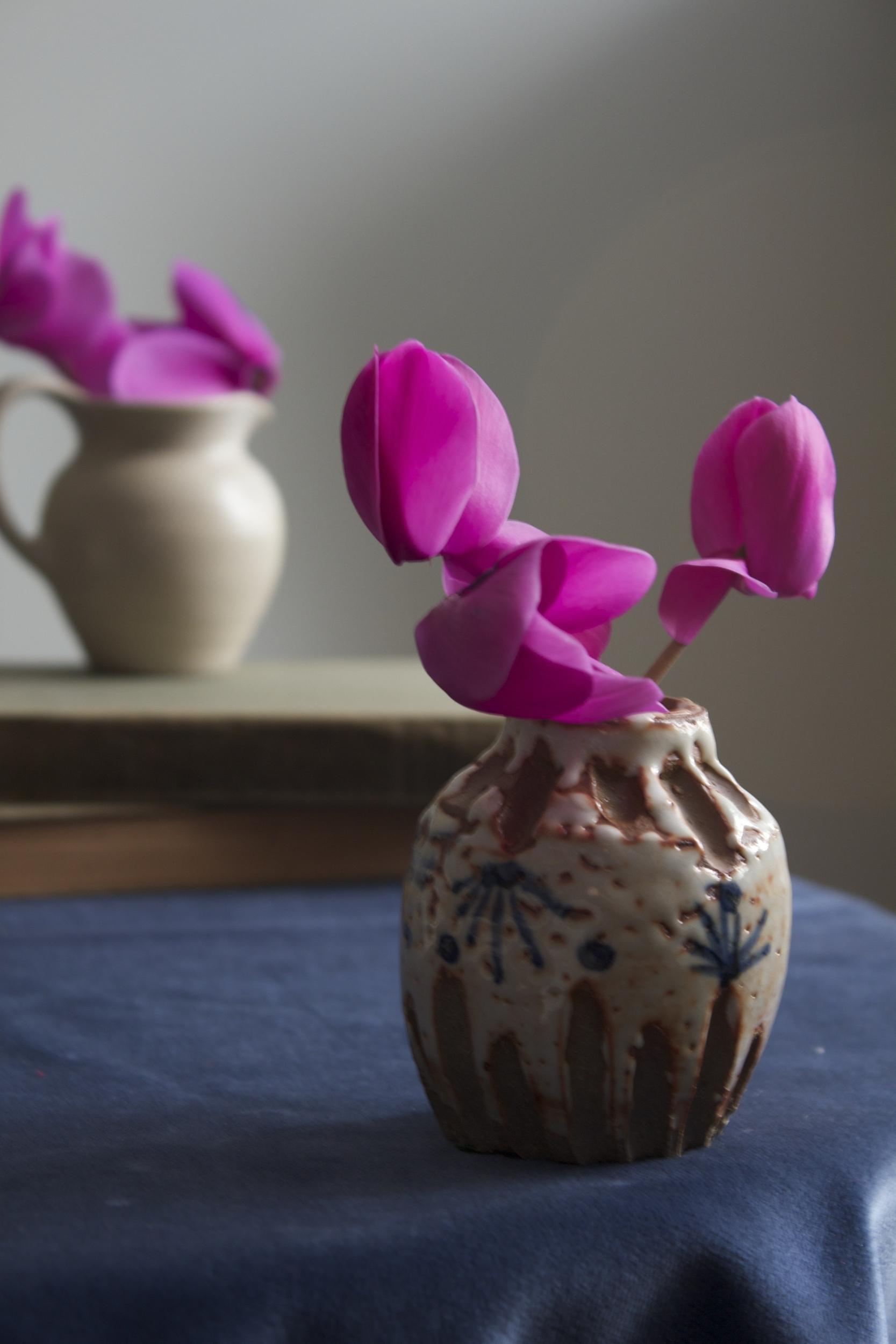 pink flowers in hand made vase.jpg