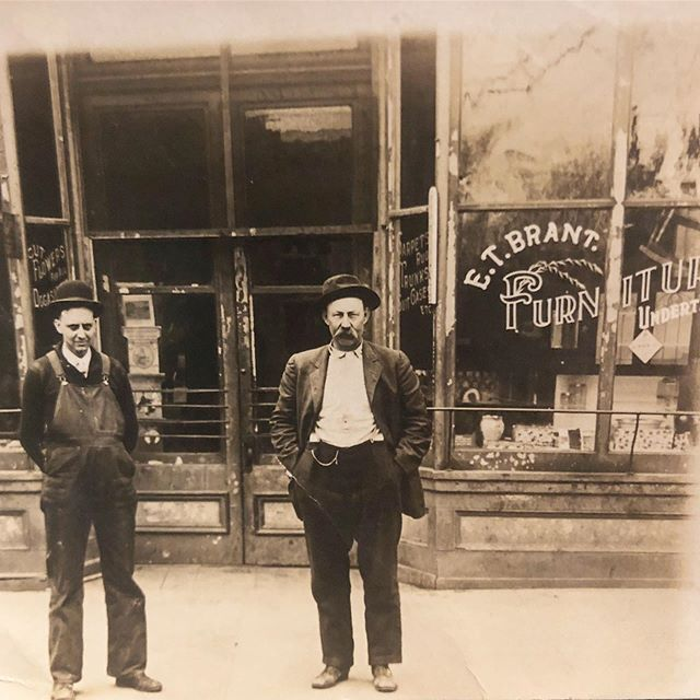 Over 100 years ago, my great grandfather (on the left) owned a furniture store - though I'm not sure his passion was in it as he also was an undertaker, and the letters we have say that the Jesse James gang would come around and drink beer with him at the shop on a regular basis. He moved from Kearney to Liberty when my grandfather was born and opened a pharmacy (being able to sell alcohol during prohibition probably didn't hurt business) and his son, my grandfather, turned it into the clothing and apparel business it still is today, @brantsclothing, where you'll see @wadulisiwoman and my nephews running around most days just like I did as a kid and my dad before, the fifth generation. It's pretty wonderful being so connected to my family history in a business, and finding this photo and reconnecting furniture just goes to show all life is just one big cycle, an eternal return #furniture #shopsmall #missouri