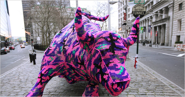 Crochet artist Olek covers a  bull near Wall Street in New York City. Photo: New York Times.