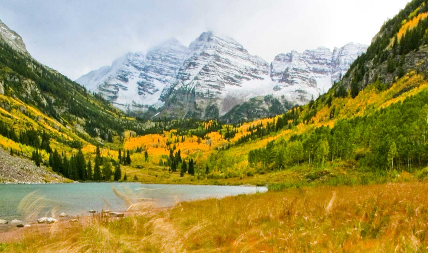 "The ""most photographed mountains in North America"" shine their brightest in the fall. That's when a stand of aspens at their base turns bright yellow blanketing their feet. Get up there now. But beware, it's also the most popular time to visit the Maroon Bells. Either ride your bike or take the shuttle, which runs from Aspen Highlands from 8 a.m. to 5 p.m. daily, for $8. After hours, guests can drive their own vehicles up as well."