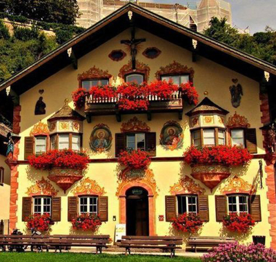 Flower boxes, murals, and wood carvings decorate this Bavarian house.