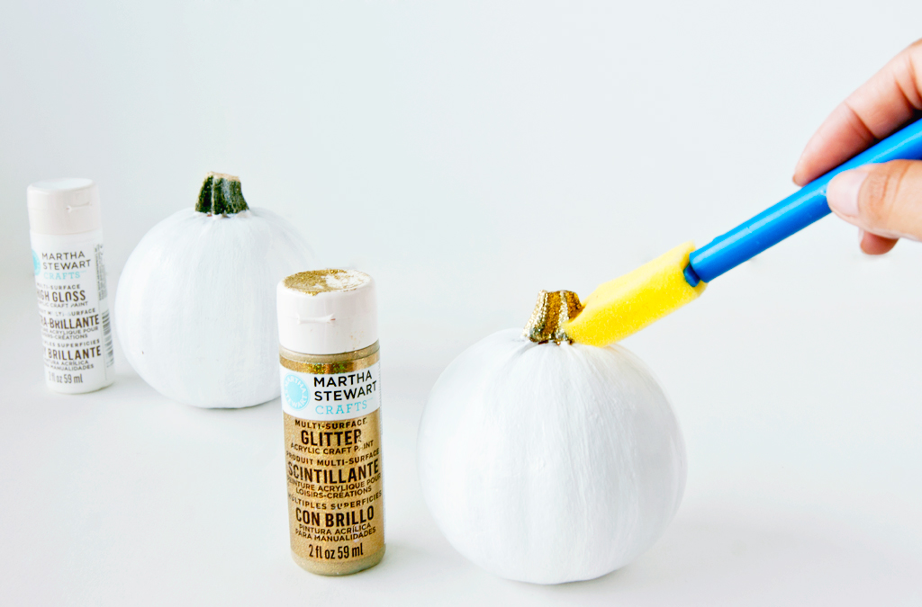 Paint your pumpkin white and add a touch of glitter gold