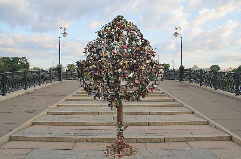 A purpose-built iron tree on a bridge across the Vodootvodny Canal in Moscow completely covered in love padlocks.