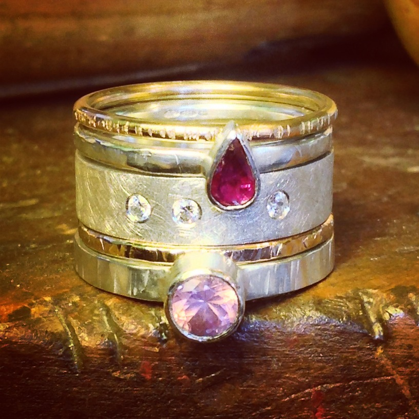 Silver and gold stacking rings set with a pear shaped vintage ruby, pink fair trade spinel and cubic zirconium.