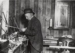 James Tubbs at his workbench in the shop at 94 Wardour Street, London. The photo taken in 1917 in his last years. (Thanks Wikipedia!)