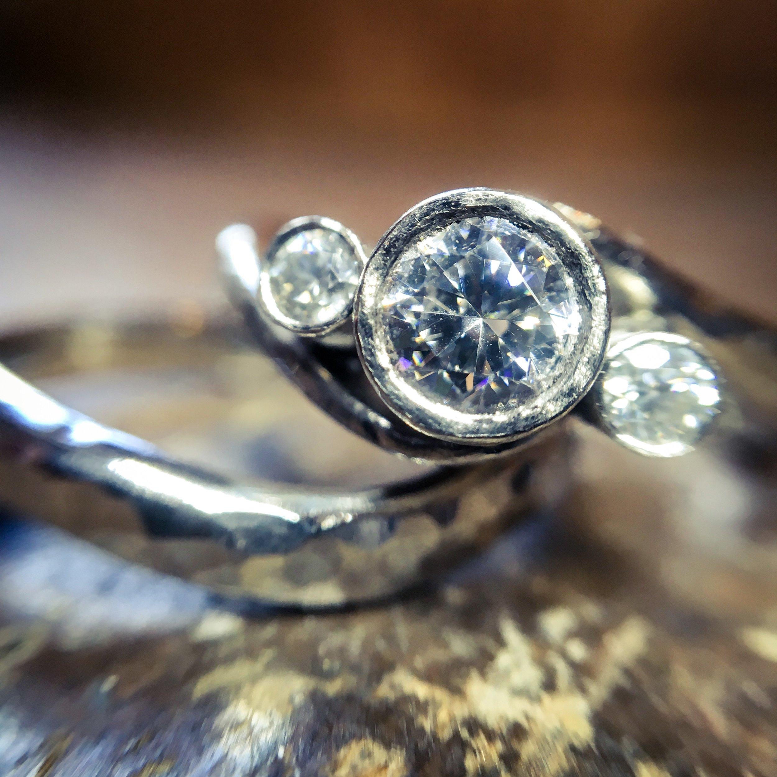 Bespoke palladium anf moissanite twist ring