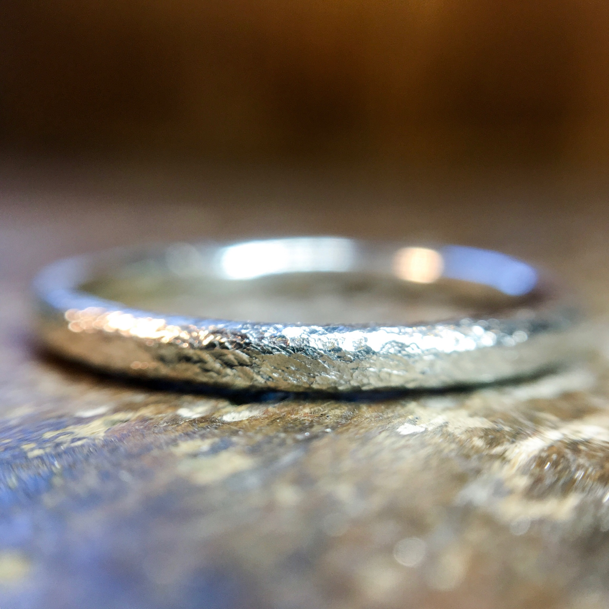 Textured halo wedding ring