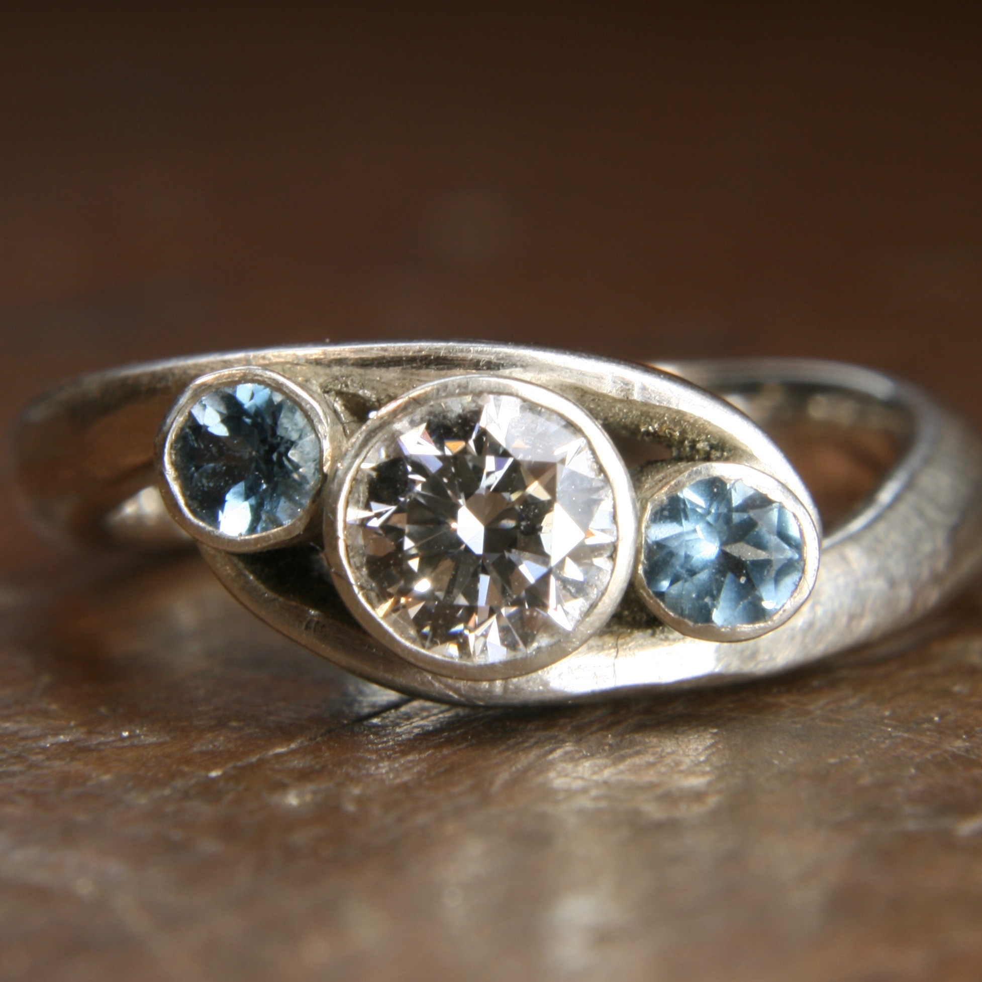 Bespoke moissanite and aquamarine twist ring