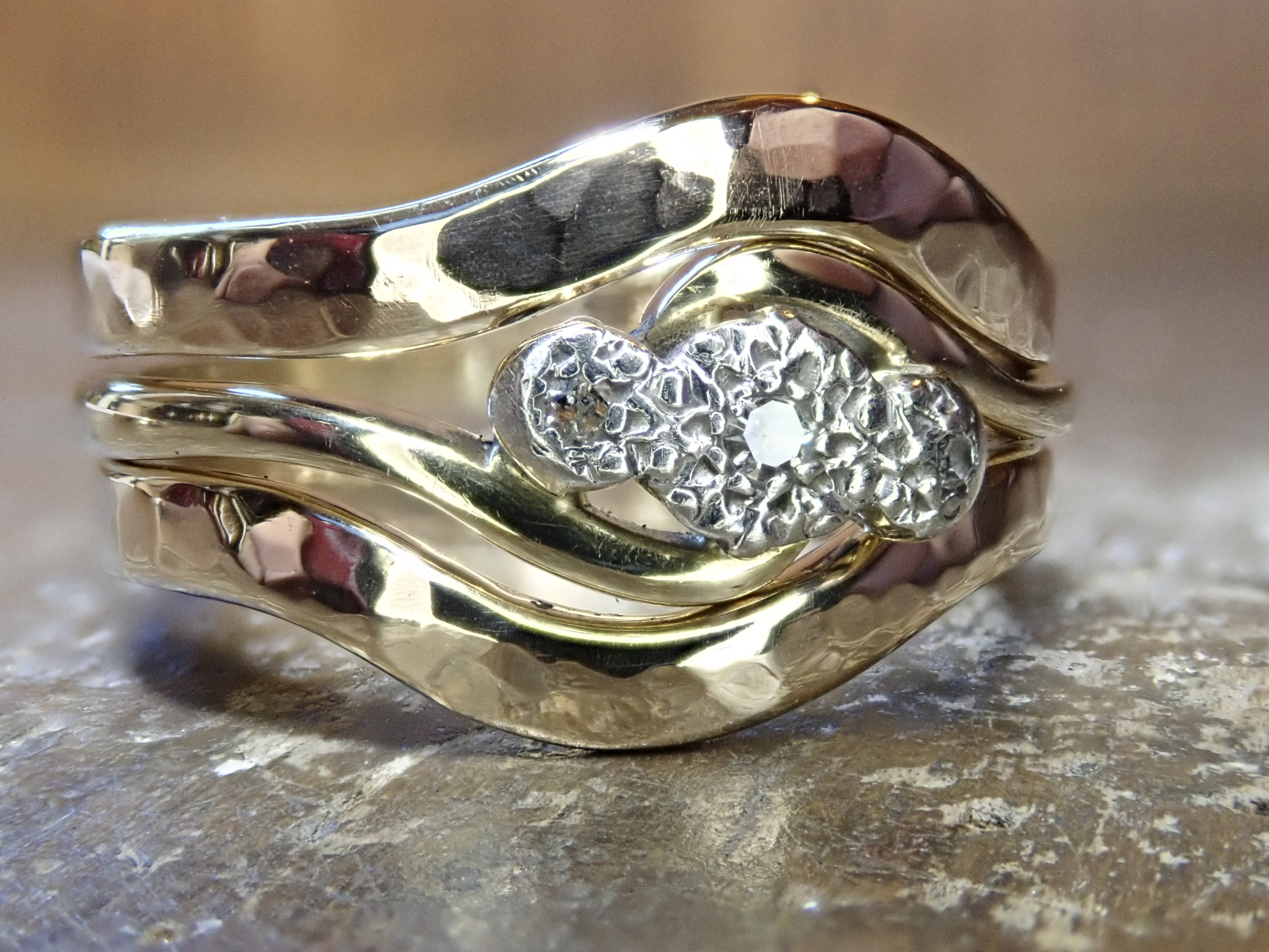 "Remodelled ""top and bottom"" wedding rings."