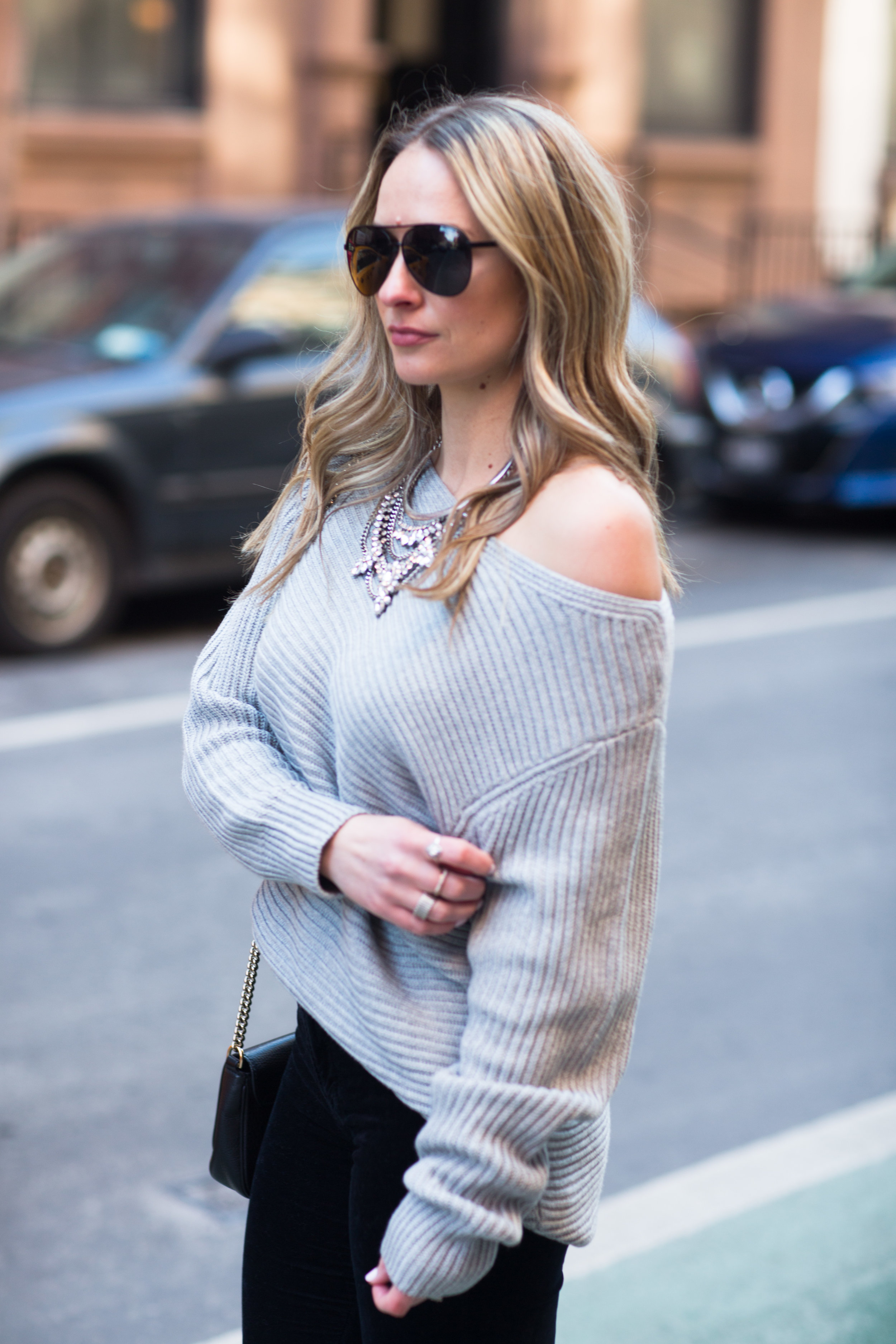 off the shoulder sweater with statement necklace
