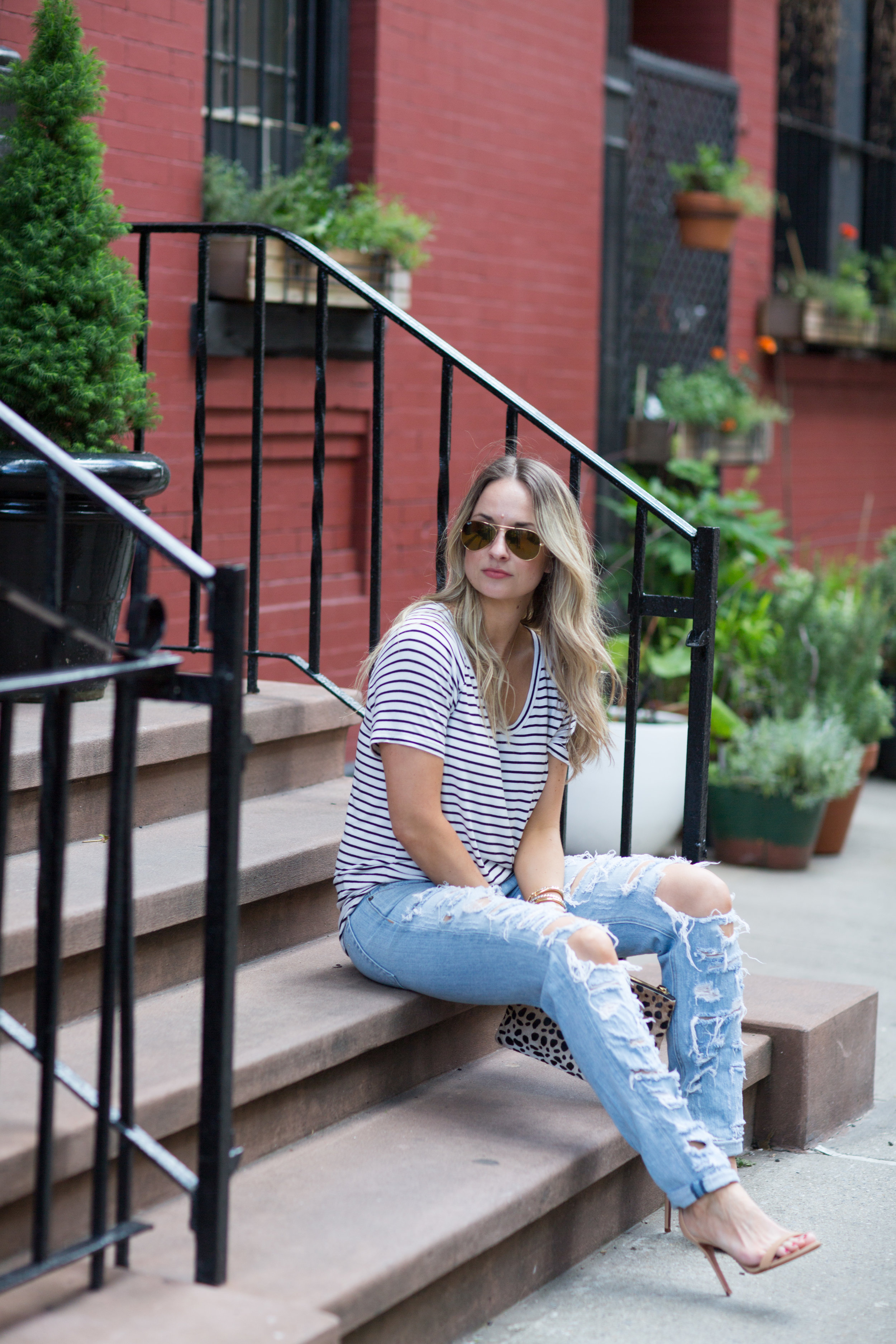 striped tee and ripped jeans