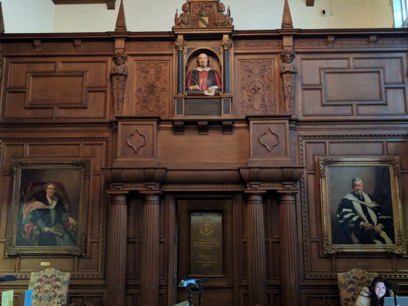 Inside the Folger Reading Room, featuring a bust of Shakespeare modeled on the one in Holy Trinity Church, portraits of Emily and Henry Folger, and the niche where their ashes are interred.