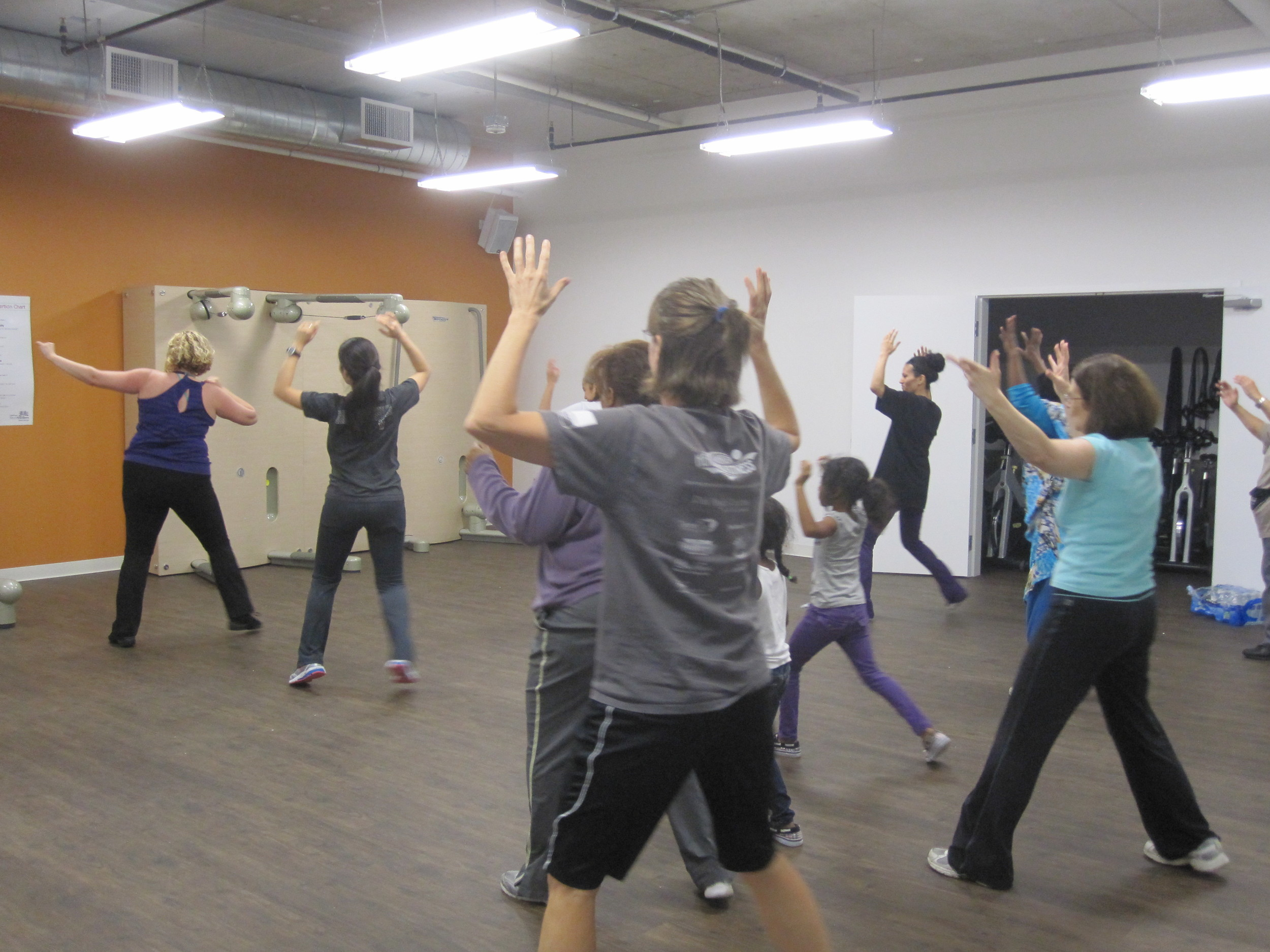 Women and girls of all ages move to the beat at a ZUMBA fitness session in our new classroom.