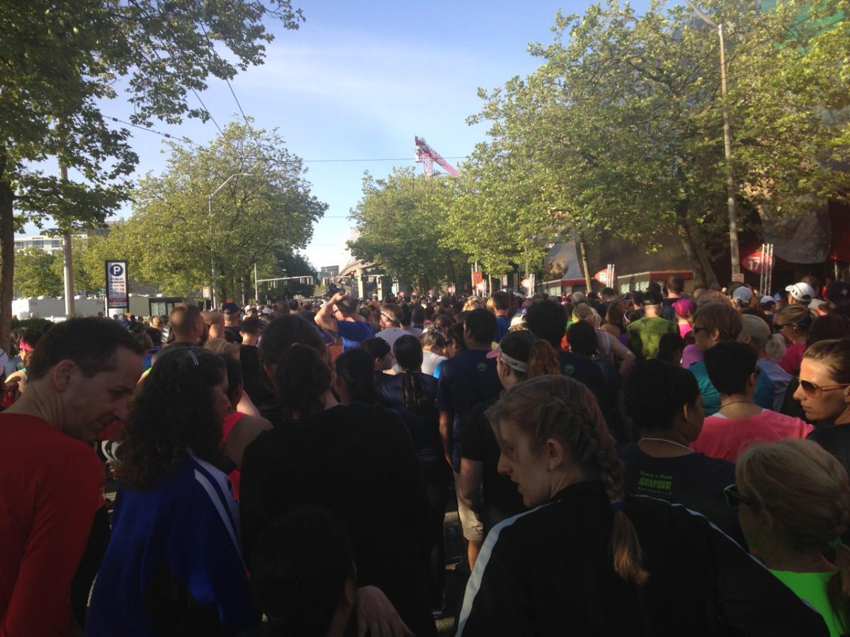 Crowd of runners line up at start line