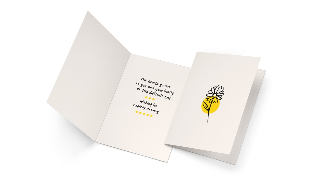 A simple sympathy card with hand written note and drawing,