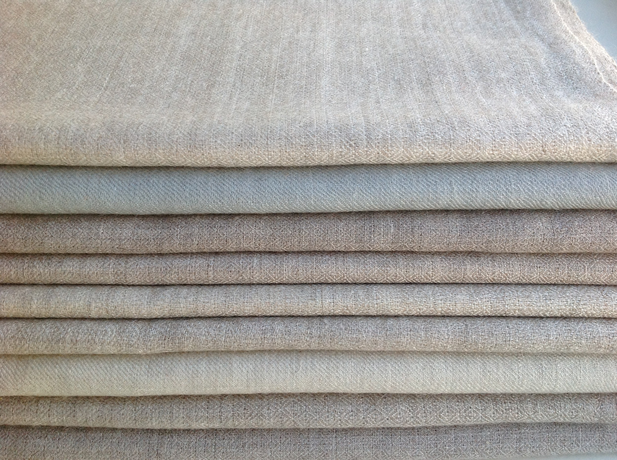 pure cashmere in different weights, including handloomed qualities