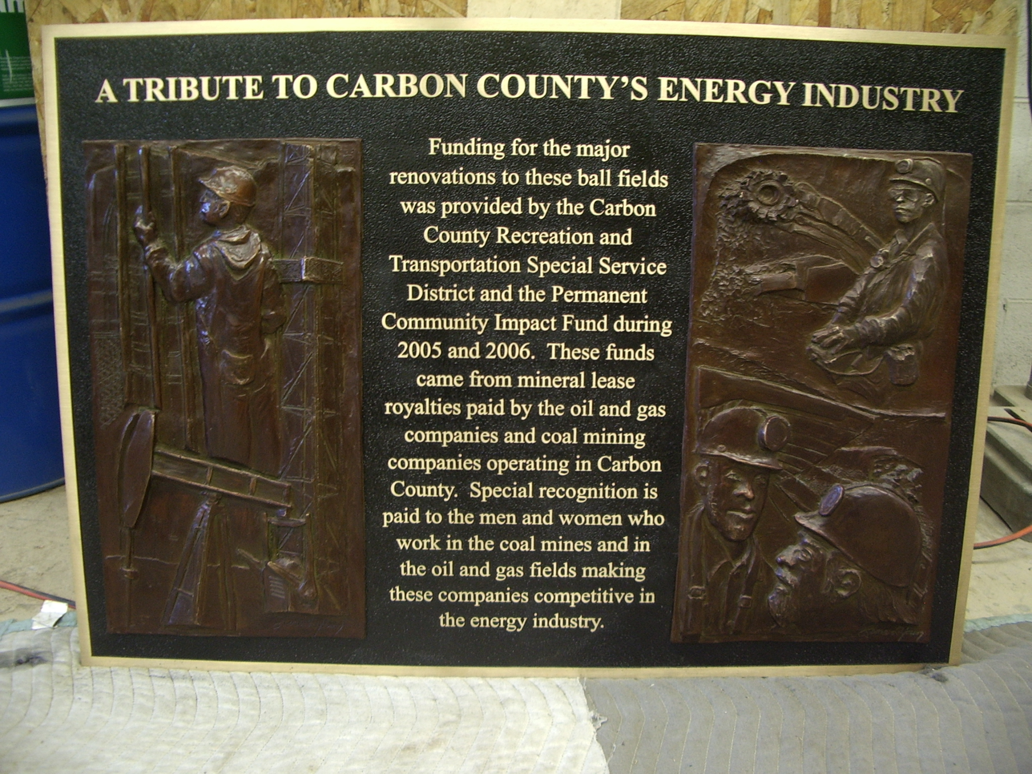 Cast bronze plaque with bas relief