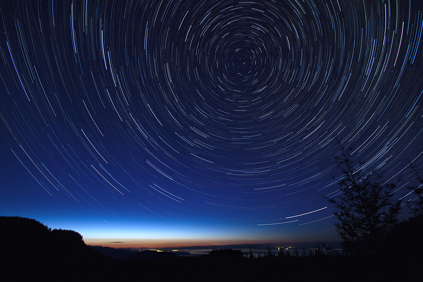 Star Trails Over Georgia Strait with a view of the lights of Courtenay and Comox