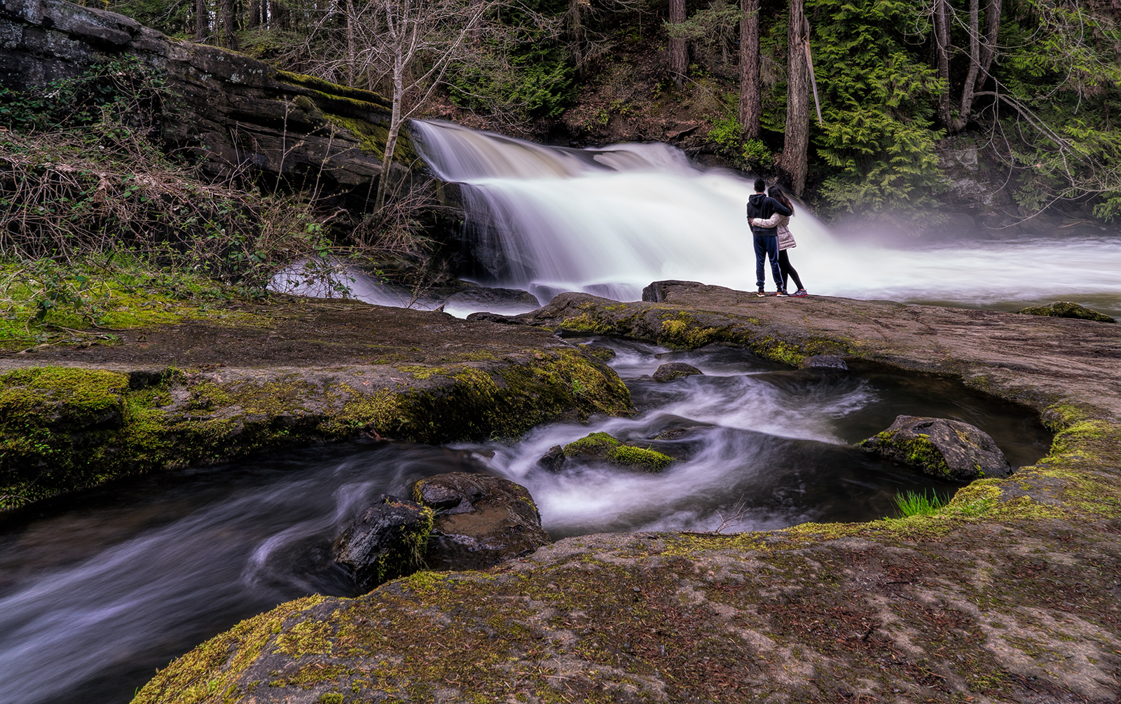 A young couple enjoys the rushing Millstone River