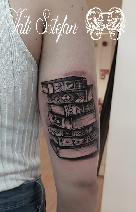 Vali fineline books on arm.jpg