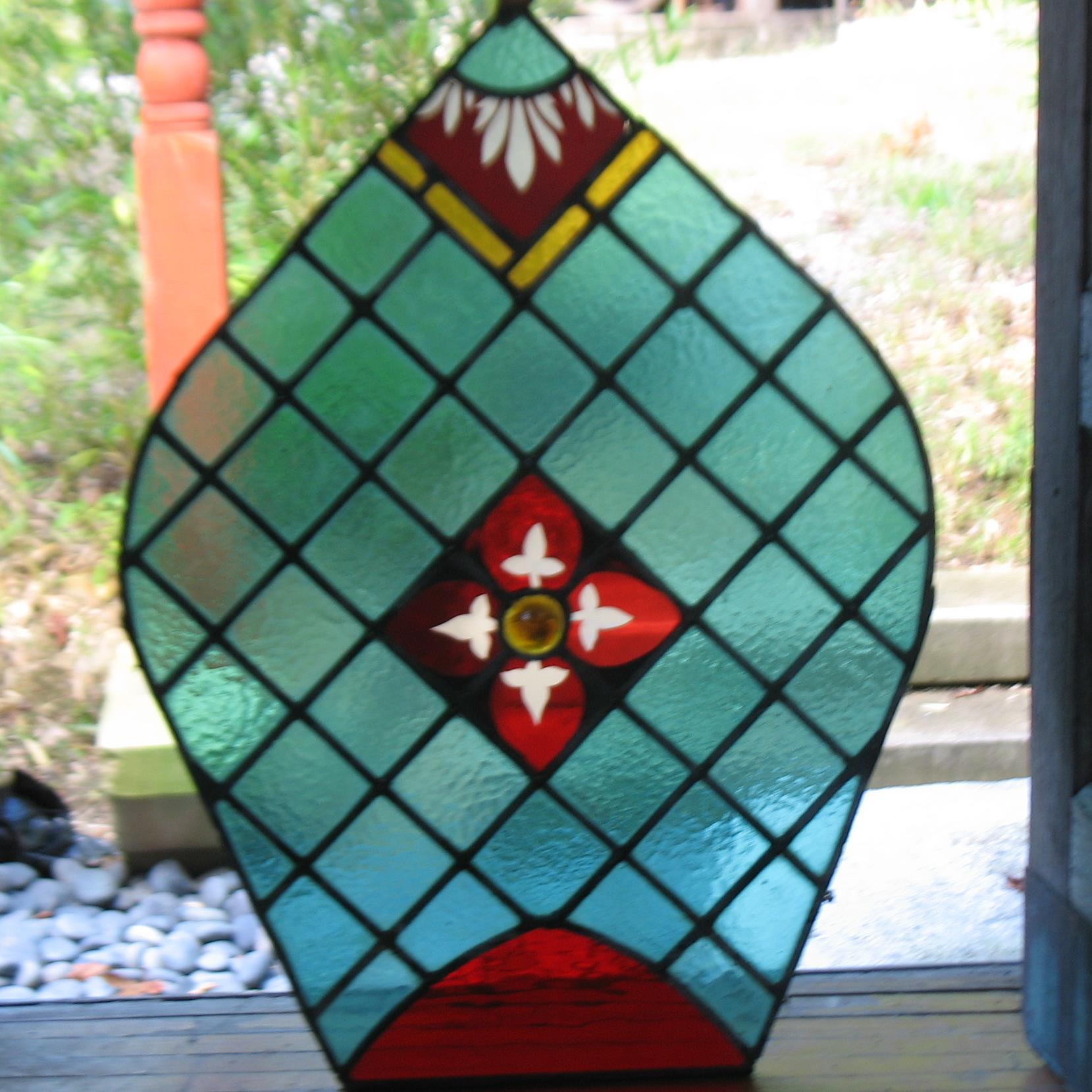 Adorable small piece of glass in vibrant red and green stained glass