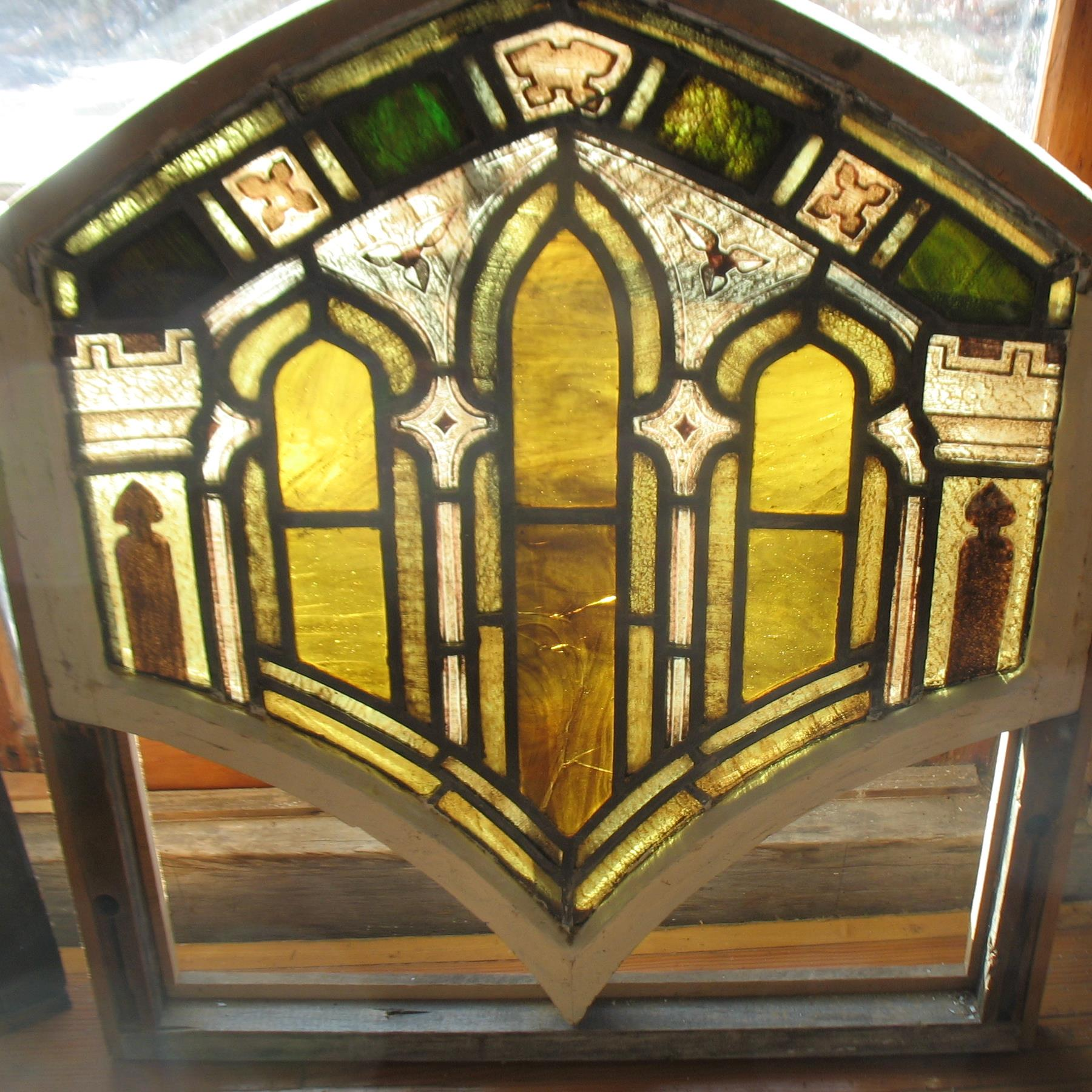 Stained Glass in unusual colors of Gold and Brown and is concave at top of window which again is very unusual