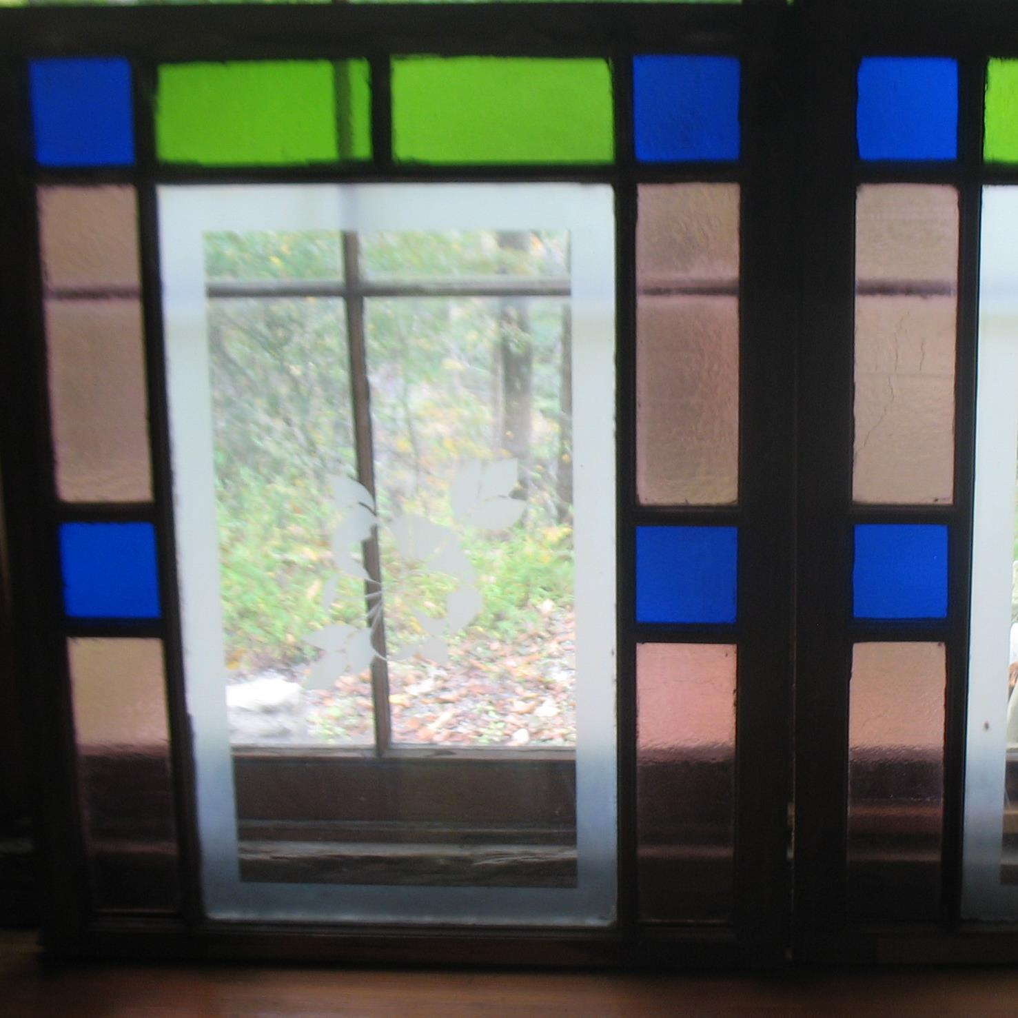 Pair Stained Glass Windows with Butterfly etchings in blues, pinks and greens