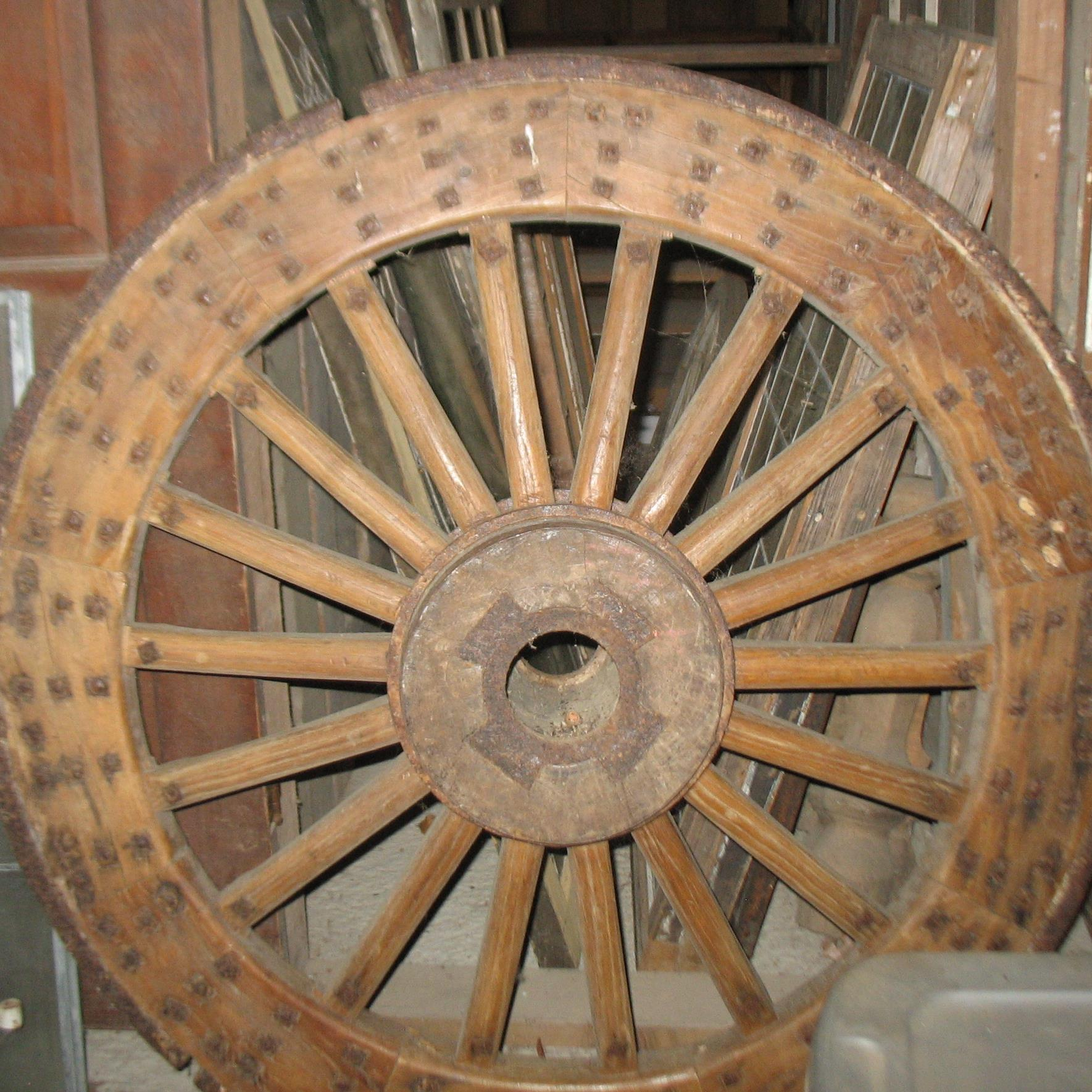 Large Chinese Wheel. All wood with cast iron rail around wheel and iron nails.  Would make wonderful table or wall hanging. Measures 6 feet across.    Price: SOLD!!