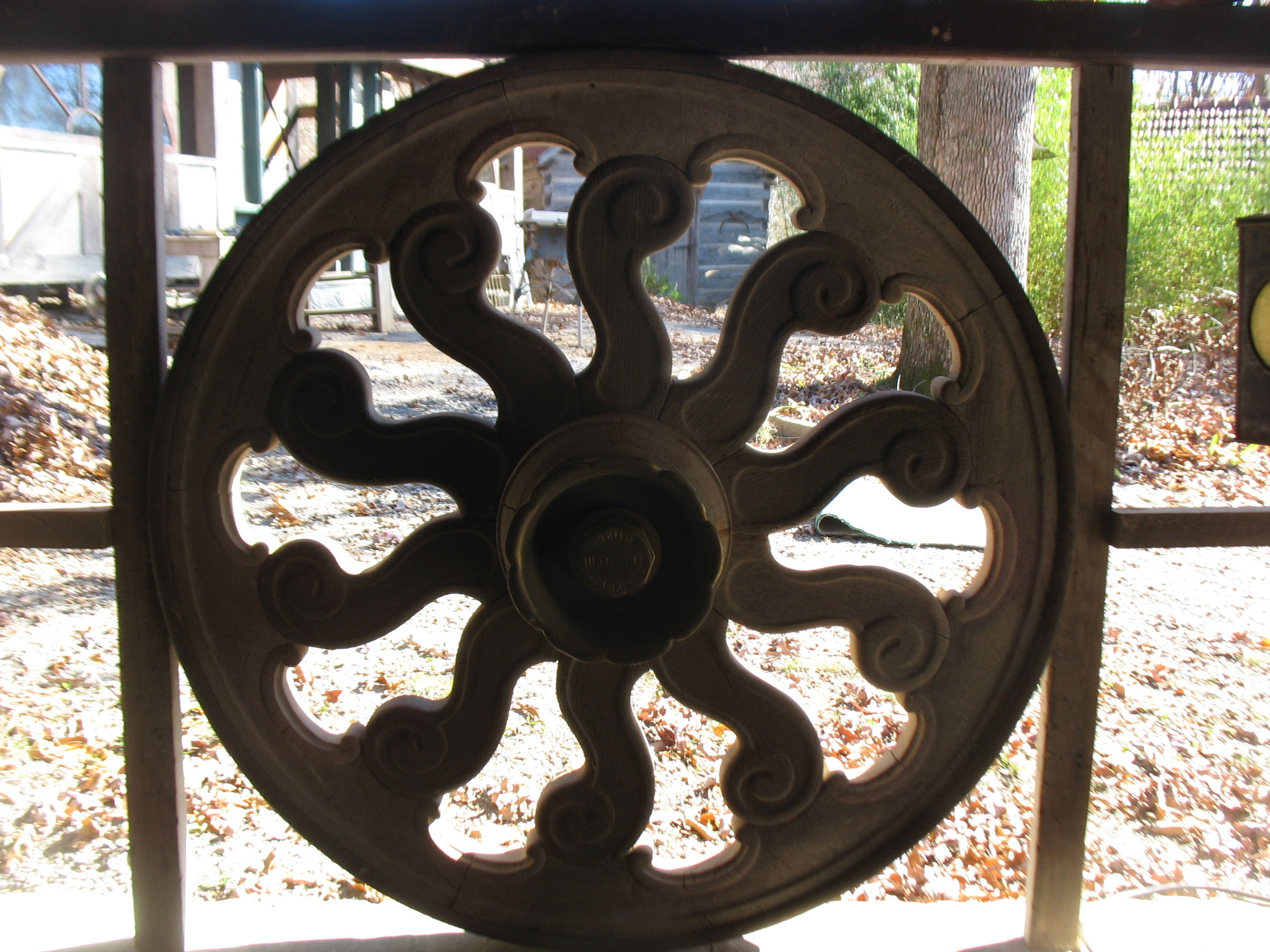 Pair wonderful decorative wheels hand carved of apple wood.  Signed and dated in Roman Numerals on hub of wheel. Would make great table or wall accent piece.     Price upon request