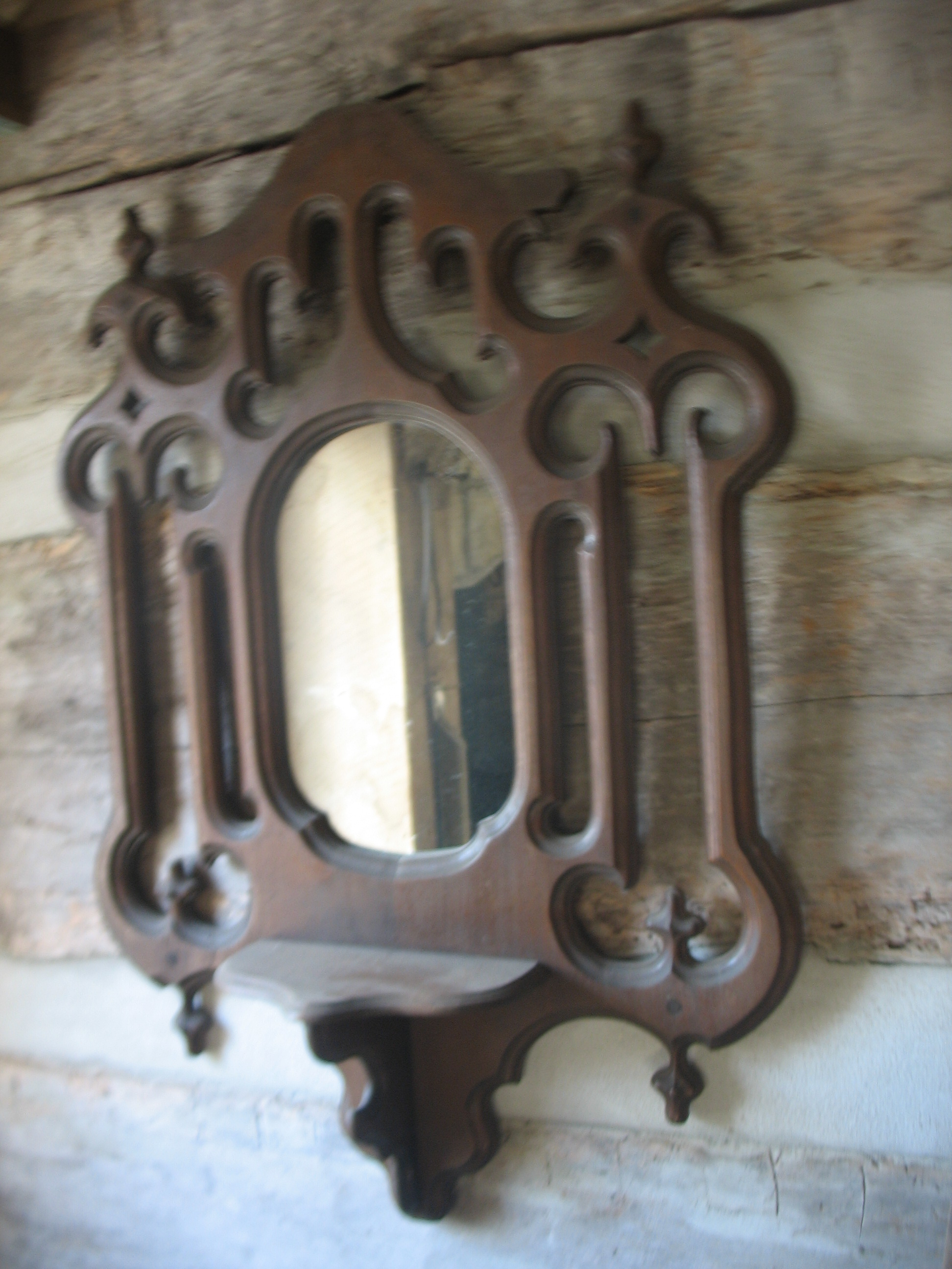 Wonderful walnut mirror in decorative design in frame surrounding mirror.    Price: SOLD