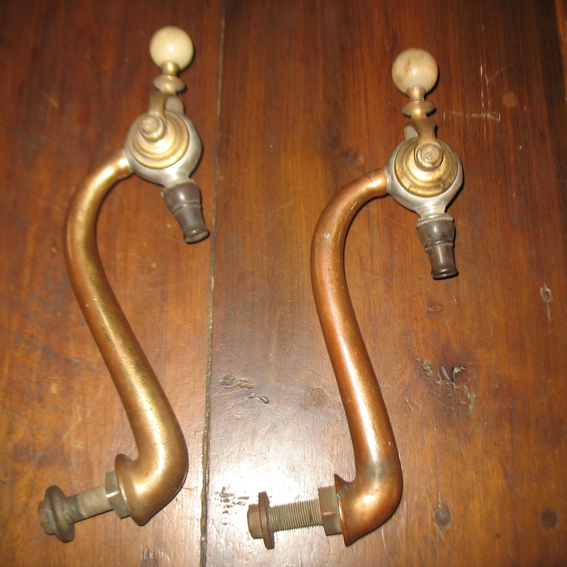 Wonderful unusual Beer Taps from a Pub in London. Perfect for your Home Bar.BraxtonDixon often uses these larger bar pieces as unusual tub fillers.These are heavy Brass with Alabaster knobs and Bakelite tips. Fill your mug with the REAL thing and enjoy knowing you have a piece of history.  Price upon request