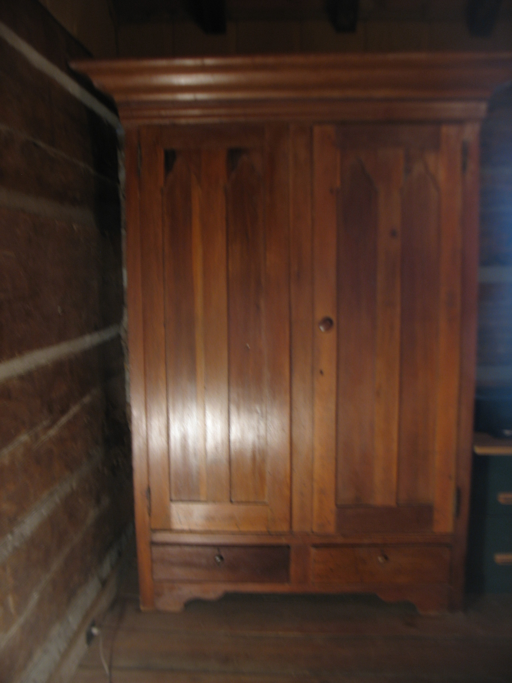 """This is a very special wardrobe, hand made in walnut, pegged together and has the largest crown molding seen for a wardrobe of this period. Overall Height 7' 3"""" X 54 inches wide for the body of the wardrobe. The crown is 5' 8"""" wide X 10 inches deep X 31"""" from back to front. There are 2 deep drawers at the bottom each 23 inches wide X 21 inches deep. Inside is 2 feet deep and 6 feet in height. There is a 23 inch walnut shelf at the top. All hardware is original to the piece. This is truly the best of the best in wardrobes."""