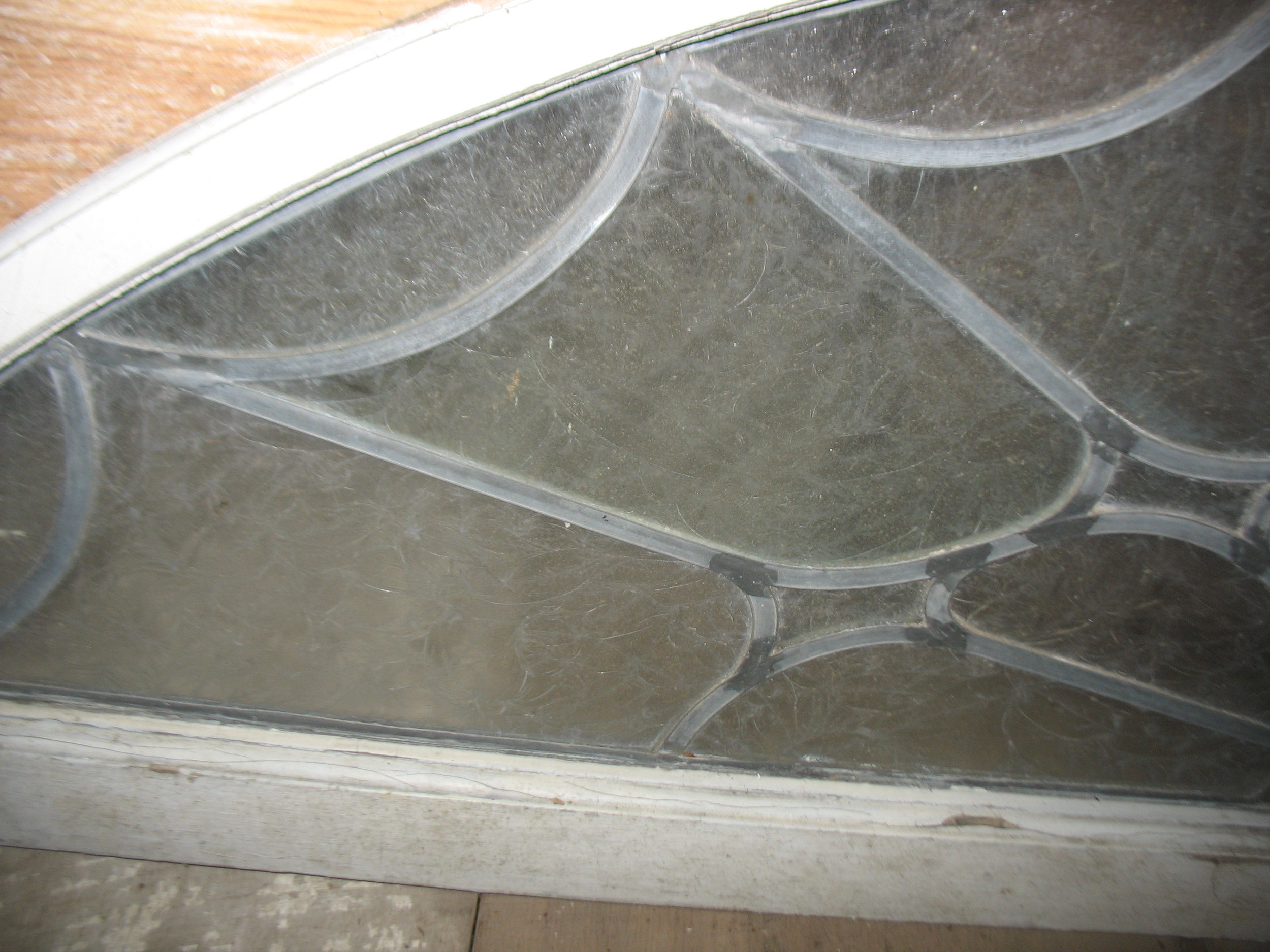 Close up of glass and leading of Transom