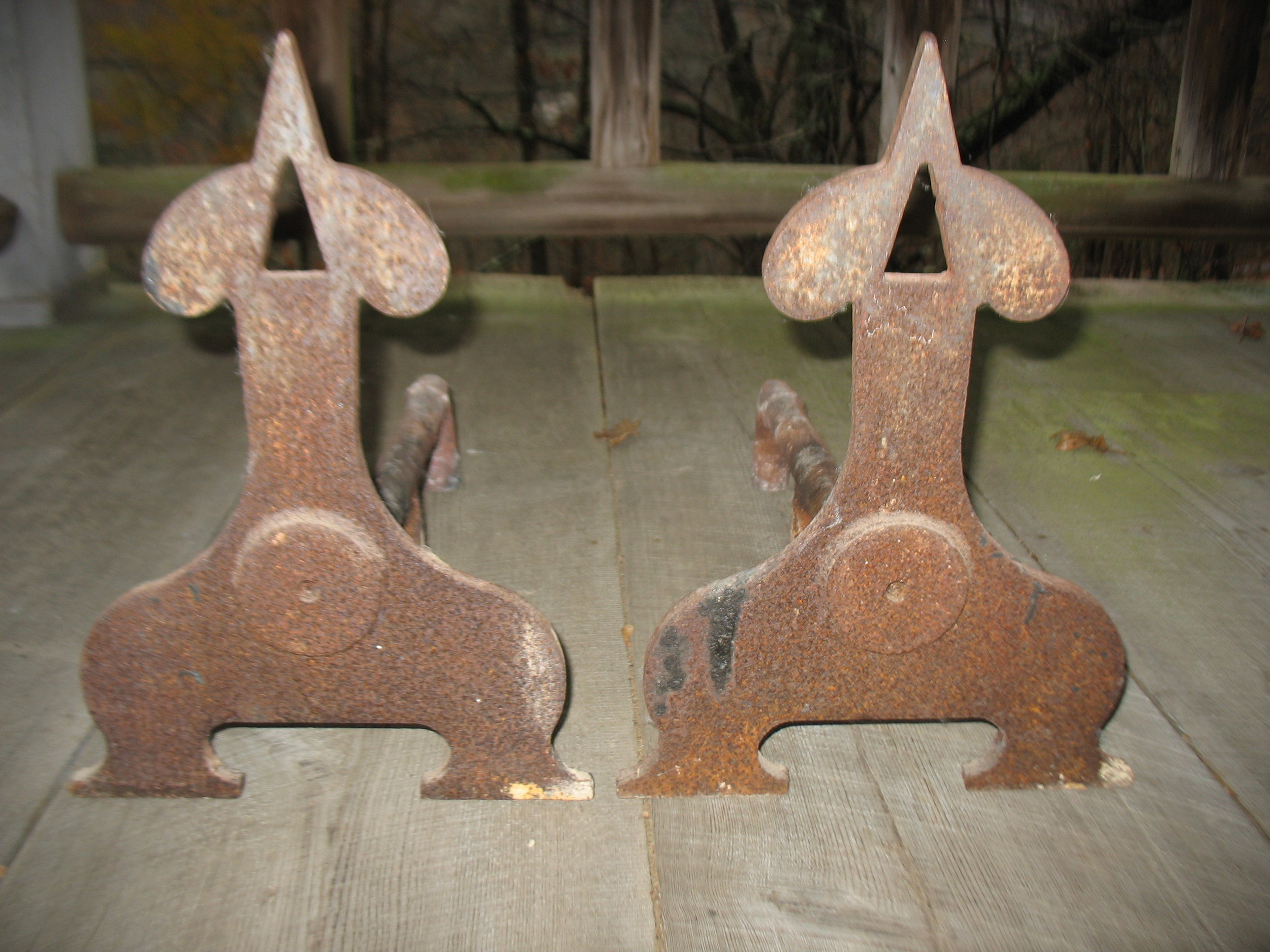 Theseare the very best for late 1700's French blacksmith made Andirons. Very heavy cast iron pair. They were shipped to us from France in 1946 after WWII. They measure 21 inches long X 18 inches tall X 12 inches wide each.    Price upon request